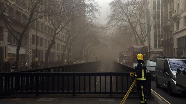 Police declared a major incident over a blaze which began under the pavement of Kingsway in Holborn