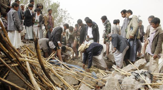 Yemenis search for survivors in the rubble of houses destroyed by airstrikes in a village near Sanaa (AP)