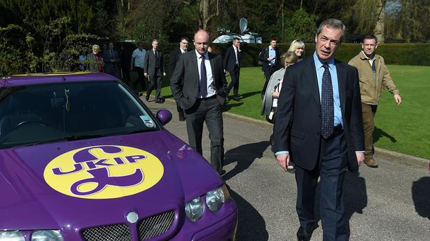 Ukip leader Nigel Farage leaves after giving a speech on defence to party supporters at Himley Hall, near Dudley in the West Midlands