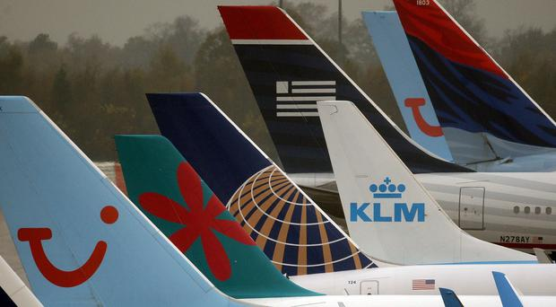 Airlines have axed scores of flights due to a strike by French air traffic controllers