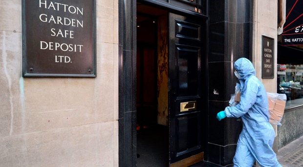 A forensics expert outside the safe deposit firm which was raided over the Easter weekend