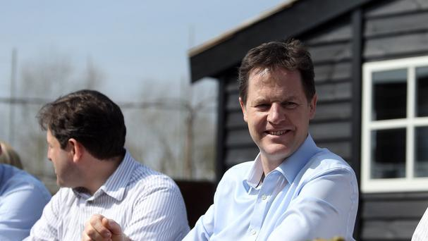 Lib Dem leader Nick Clegg takes a break after a local activist rally in Holt, Wiltshire at The Glove Factory Cafe