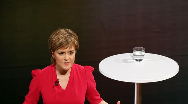 Nicola Sturgeon is to challenge Ed Miliband on NHS funding