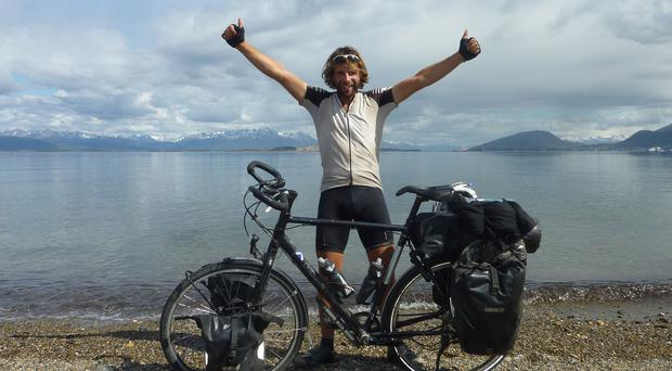 Mark Beaumont celebrates after his finishing his Cycling the Americas adventure in Argentina (BBC)