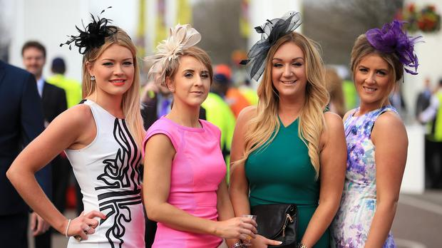 Female racegoers arrive ahead of the day's racing on Ladies Day