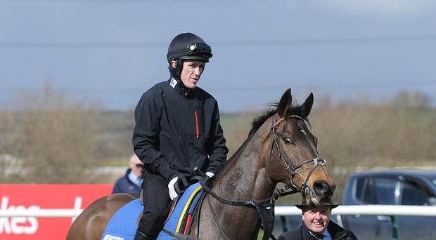 AP McCoy chats to trainer Jonjo O'Neill after exercising Grand National runner Shutthefrontdoor