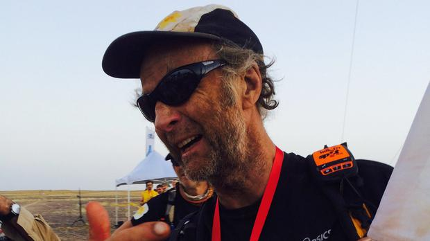 Sir Ranulph Fiennes after crossing the finish line during the sixth day of the Marathon des Sables (Marie Curie Cancer Care/PA)