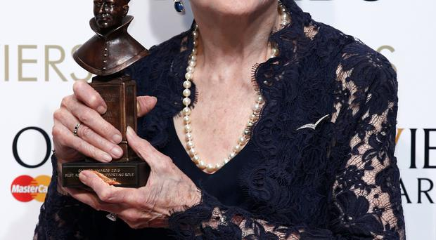 British-American actress Angela Lansbury poses with the award for best actress in a supporting role for her work on play 'Blithe Spirit' during the Lawrence Olivier Awards for theatre at the Royal Opera House in central London