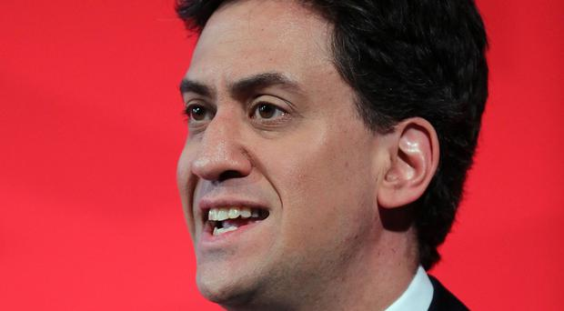 Ed Miliband says Labour will cut the deficit every year until Britain is back in the black