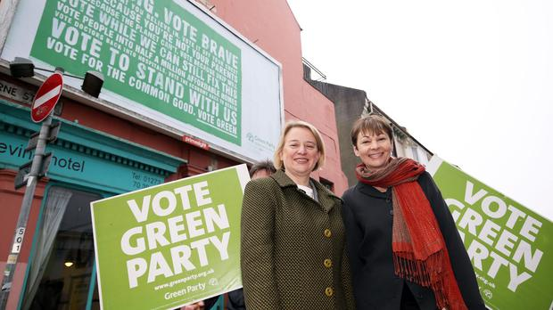 Green Party leader Natalie Bennett, left, with Brighton Pavilion parliamentary candidate Caroline Lucas during the launch of the party's billboard campaign in the city