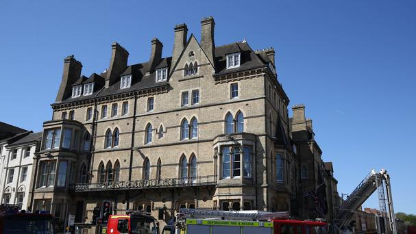 Emergency crews at Macdonald Randolph Hotel in Oxford city centre after a fire ripped through the five-star residence