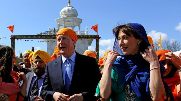 Prime Minister David Cameron and his wife Samantha during a visit to the Guru Nanak Darbar Gurdwara in Gravesend