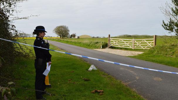 Police at the Old Buckenham Airfield near Attleborough, Norfolk, after a pilot died after crashing during an aerobatics display.