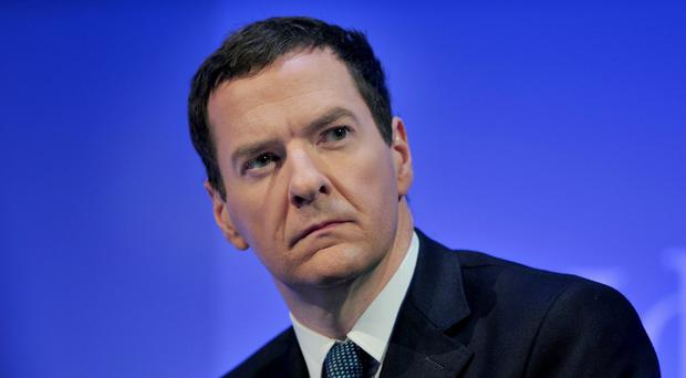 Chancellor George Osborne has been boosted by figures showing that public sector borrowing fell to £87.3 billion in the year to March from £98.5 billion in 2013/14