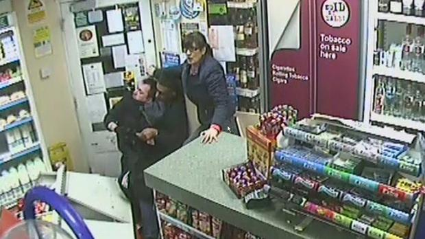 A CCTV picture of Shaun Andrew McKerry being leapt on by shop-owner Sab Dhillon