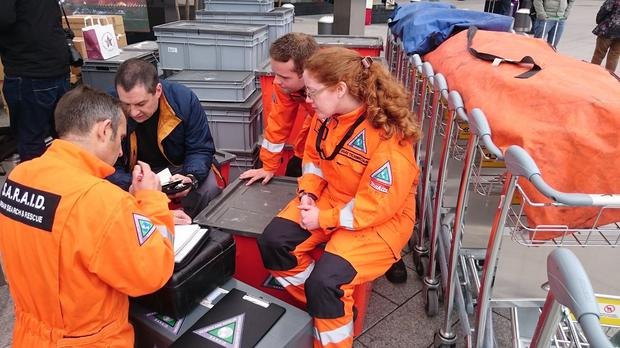 Volunteers from British charity Search and Rescue Assistance in Disasters (SARAID) check their equipment at Heathrow airport
