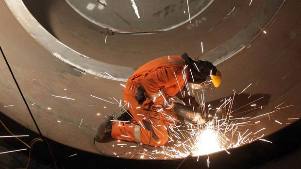 A welder at work as growth figures published this week look set to show that the UK's economic expansion slowed down at the start of this year.