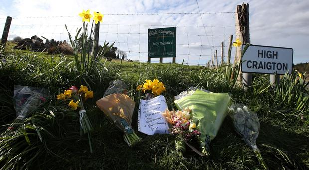 Floral tributes at High Craigton Farm, where the body of Karen Buckley was found