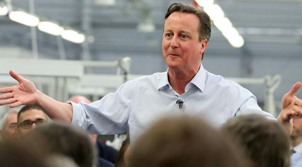 David Cameron speaks to workers during a visit to Kelvin Hughes Voltage in London