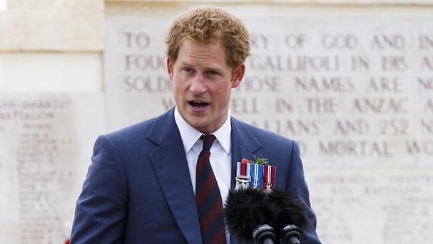 Prince Harry, pictured speaking at a Gallipoli memorial service in Turkey, is said to be looking forward to his first official tour of New Zealand.
