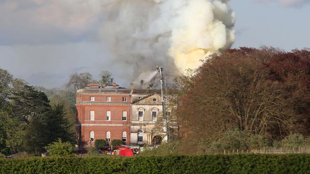 Firefighters battle a blaze at Clandon House, a National Trust property near Guildford, Surrey