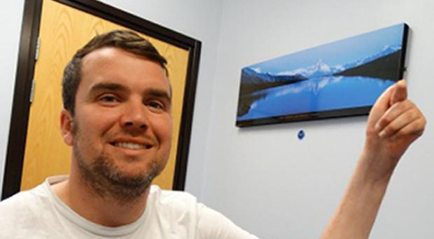 Former serviceman Craig Stewart can now move his fingers for the first time since severing his arm in a car crash a decade ago (Morriston Hospital/PA)