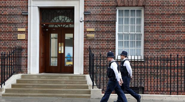 Police walk past the Lindo Wing in London where the Duchess of Cambridge is due to give birth.