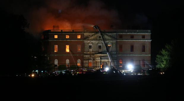 Firefighters tackle the blaze at Clandon Park, an 18th century National Trust property near Guildford