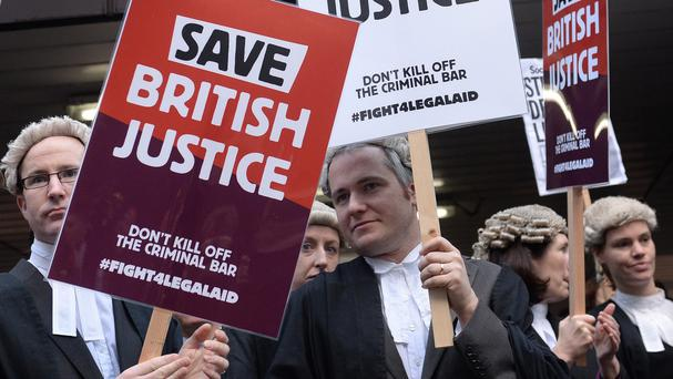 Barristers and solicitors outside Southwark Crown Court, London, during a nationwide strike against Government plans to cut legal aid