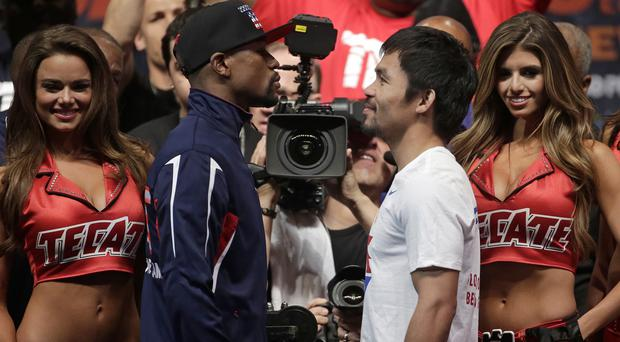Floyd Mayweather Jr and Manny Pacquiao posing during their weigh-in before their Las Vegas bout (AP)