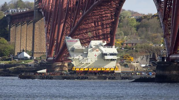 The bridge of HMS Prince of Wales passing under the Forth Bridge as it is delivered to Rosyth for assembly (Michael McGurk/Aircraft Carrier Alliance/PA)