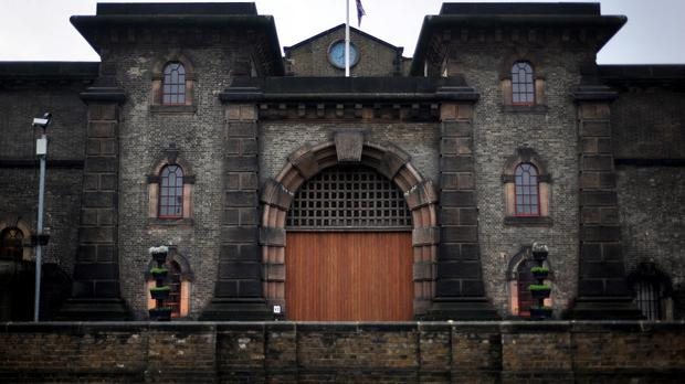 A man has been arrested after an inmate at Wandsworth prison was killed in his cell