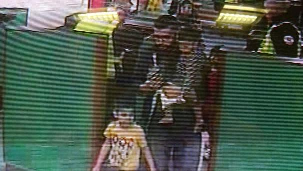 Asif Malik and Sara Kiran and their four young children travelling through the port of Dover (Thames Valley Police CCTV)