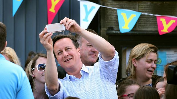 Prime Minister David Cameron takes a selfie, as voters are advised against polling station photography