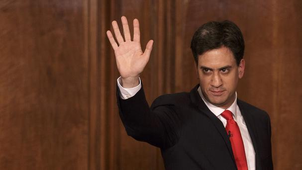 Ed Miliband waves as he leaves after delivering his resignation.