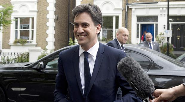 Ed Miliband arrives at his home in north London following his resignation.