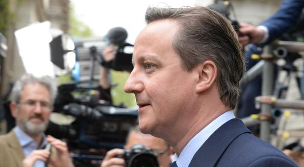 Prime Minister David Cameron returns to 10 Downing Street.