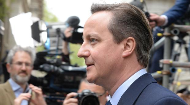 David Cameron moved swiftly by reappointing Chancellor George Osborne, Foreign Secretary Philip Hammond, Home Secretary Theresa May and Defence Secretary Michael Fallon