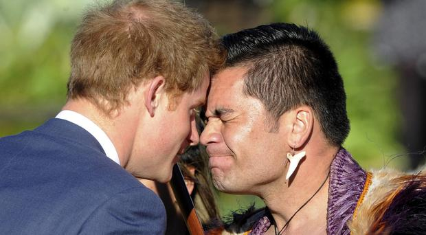 Prince Harry receives a traditional Maori hongi greeting with Kairangi (welcome) leader Thomas Vela at Government House in Wellington, New Zealand (SNPA/AP)