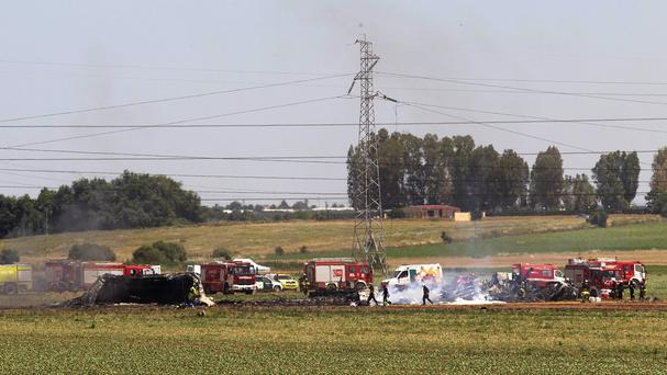 Emergency services at the scene after a military plane crash near Seville airport in Spain (AP)
