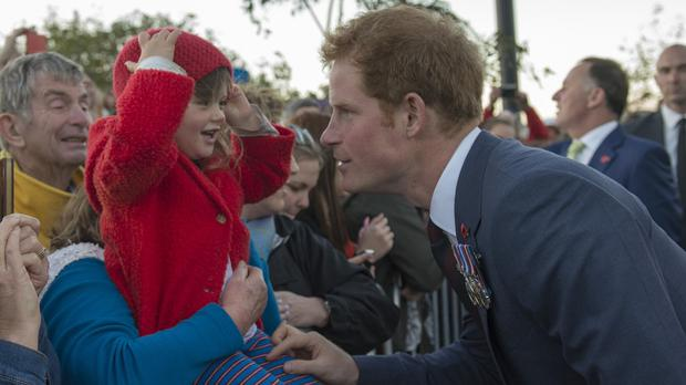 Prince Harry meets Mala Kershaw, three, from Wellington, during a visit to Pukeahu National War Memorial Park