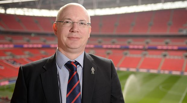 Football League boss Shaun Harvey is one of those reading out the names of the victims at the service