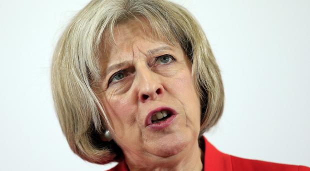 Home Secretary Theresa May says the Government is determined to defeat extremism