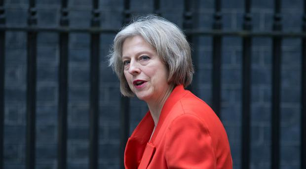 Theresa May said she will resist calls for the mandatory relocation or resettlement of migrants across Europe