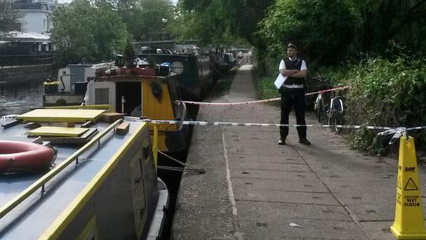 The body was found in the Grand Union Canal in west London on Sunday afternoon