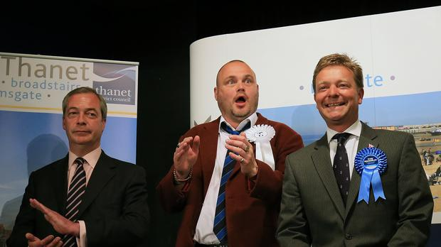 Craig Mackinlay (right) savours his victory at the expense of a field including Nigel Farage (left) and The Pub Landlord