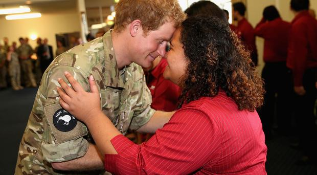 Prince Harry receives a traditional Maori greeting called hongi during his tour of New Zealand