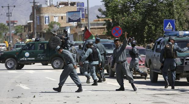 Afghan security forces inspecting the site of the explosion in Kabul (AP)