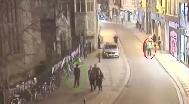 CCTV footage shows the two Libyan men on the streets of Cambridge. Moktar Ali Saad Mahmoud, circled in green, and Ibrahim Abugtila, circled in red, have been convicted of raping a man (Cambridgeshire Police/PA Wire)