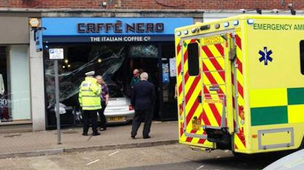 Emergency services at the scene of an accident at the Caffe Nero in Gerrards Cross, Buckinghamshire, after a Porsche crashed into the front of the building (Jenny Hodge)